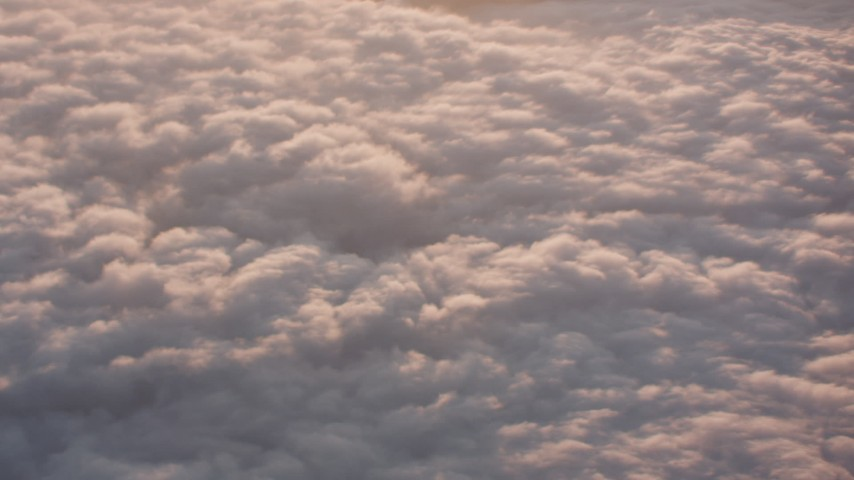 Flyby sunset-lit clouds and tilt to the clouds below in Southern California Aerial Stock Footage | WA005_007