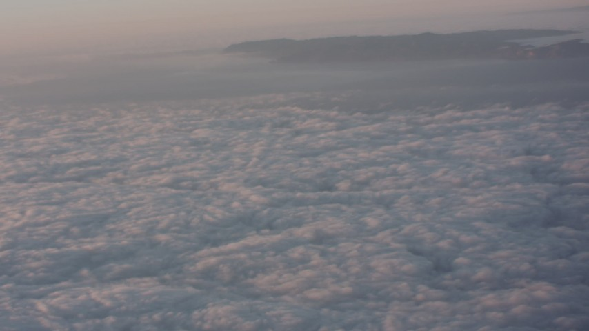 4K stock footage aerial video pan across cloud layer surrounding mountains at sunset in Southern California Aerial Stock Footage | WA005_008