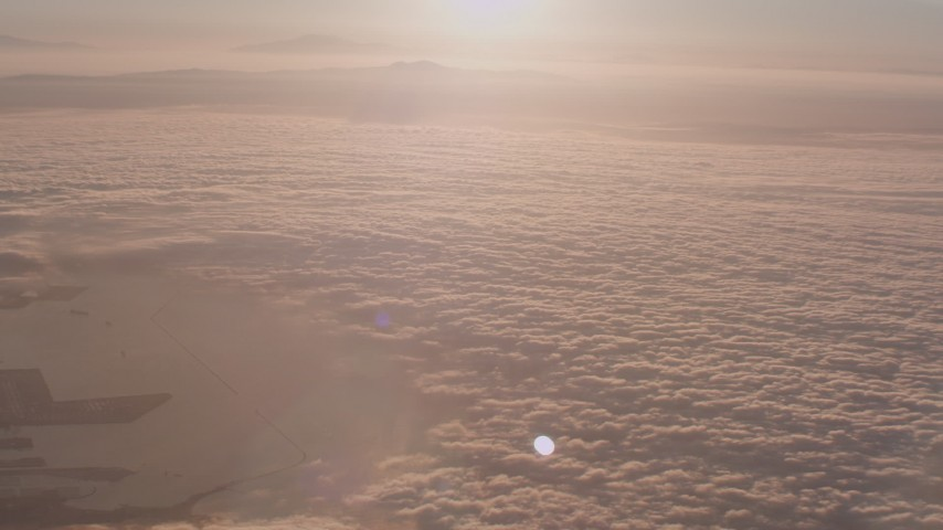 Fly over cloud layer covering the Pacific Ocean at sunset near San Pedro, California Aerial Stock Footage | WA005_010