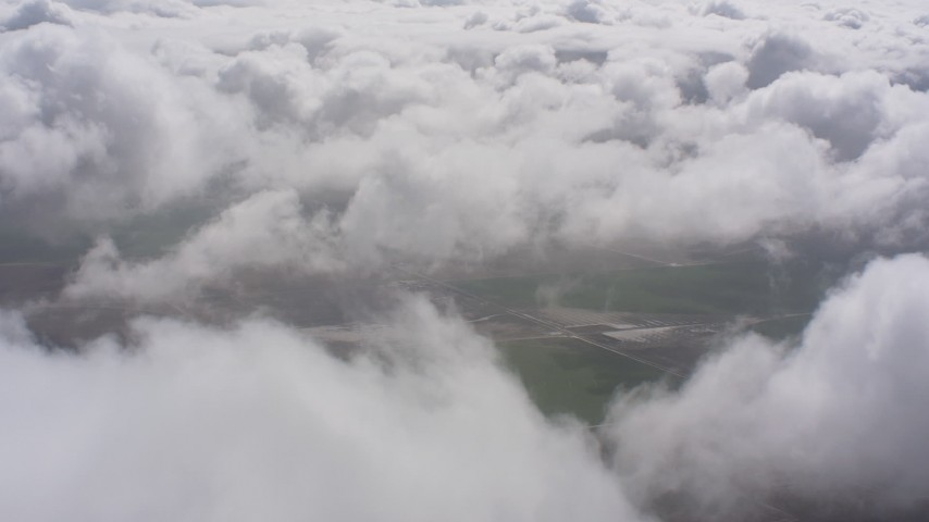 4K stock footage aerial video of farm fields and white clouds in Southern California Aerial Stock Footage | WA005_023
