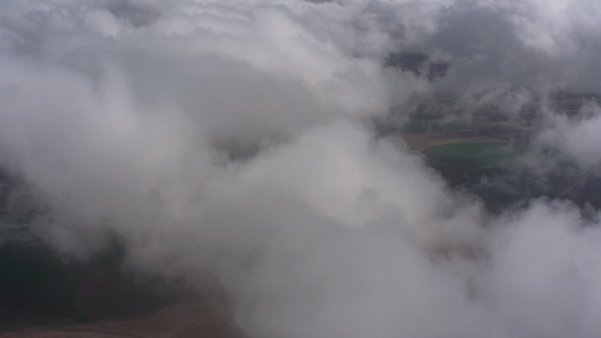 4K stock footage aerial video fly over clouds above farmland, Southern California Aerial Stock Footage | WA005_024