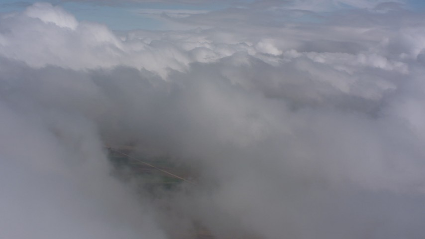 4K stock footage aerial video of passing white clouds over Southern California Aerial Stock Footage | WA005_025