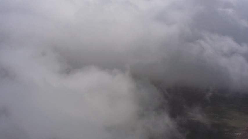 Fly into dense white cloud cover over Southern California Aerial Stock Footage | WA005_026