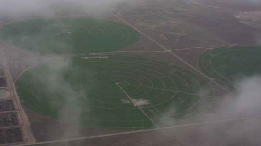 Flyby clouds to reveal circular crop fields in Kansas Aerial Stock Footage WA005_028 | Axiom Images