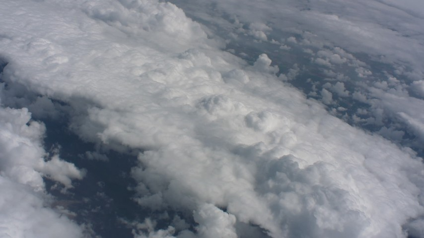 Tilt from a bird's eye view of clouds to a wider view of the cloud layer over Kansas Aerial Stock Footage WA005_050   Axiom Images