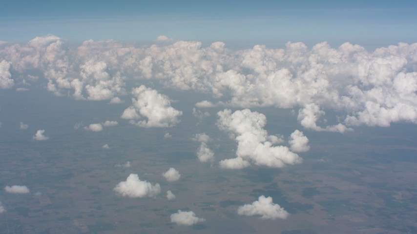 A view of cloud formations over Kansas farmland Aerial Stock Footage WA005_058 | Axiom Images
