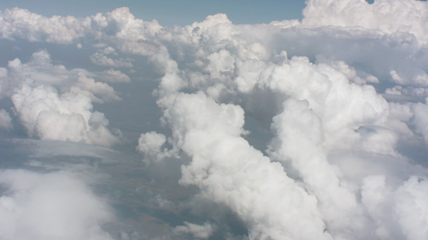 Patchy clouds and a large cloud formation over Kansas farmland Aerial Stock Footage WA005_062   Axiom Images