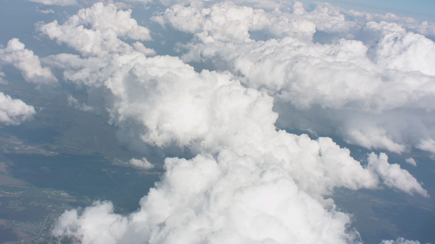 Tilt from a cloud over Ohio to larger formations in the background Aerial Stock Footage | WA005_081