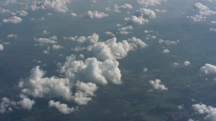 A view of partly cloudy skies above West Virginia, tilt to a cloud formation Aerial Stock Footage | WA005_098