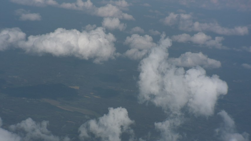 Tilt to a wide view of clouds over rural Virginia Aerial Stock Footage | WA006_002