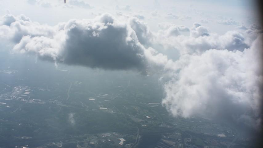 Pan across cloud over Virginia towns Aerial Stock Footage | WA006_008