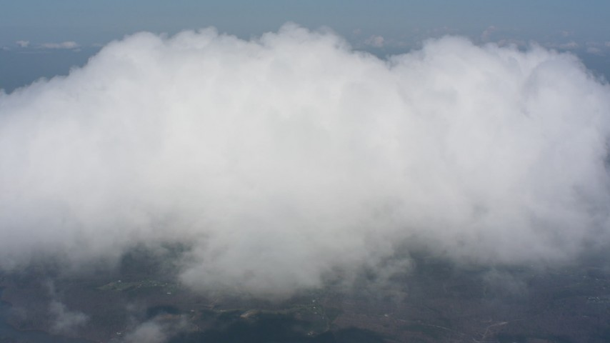 Approach and flying over a cloud above rural Virginia towns Aerial Stock Footage WA006_010 | Axiom Images