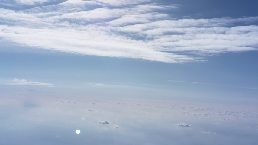Flying between cloud layers high above North Carolina Aerial Stock Footage WA007_005 | Axiom Images