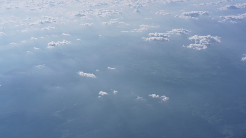 Tilt from farmland to reveal clouds high above North Carolina Aerial Stock Footage WA007_008   Axiom Images