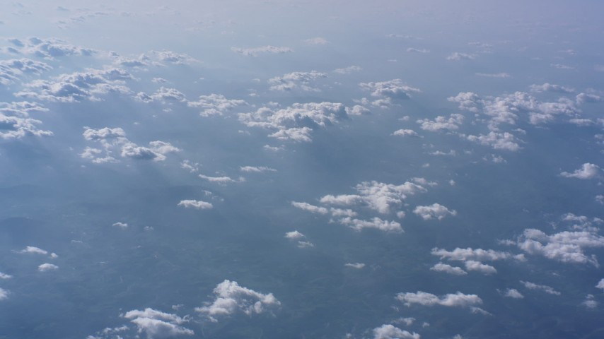 Tilt to clouds backlit by the sun high above North Carolina countryside Aerial Stock Footage WA007_012 | Axiom Images