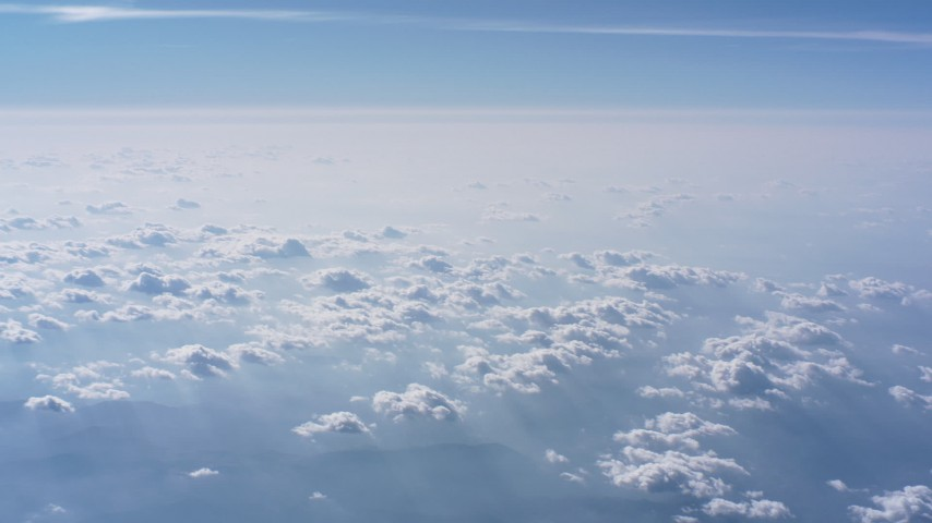 Pan from a larger cloud formation to smaller ones over North Carolina Aerial Stock Footage WA007_013 | Axiom Images