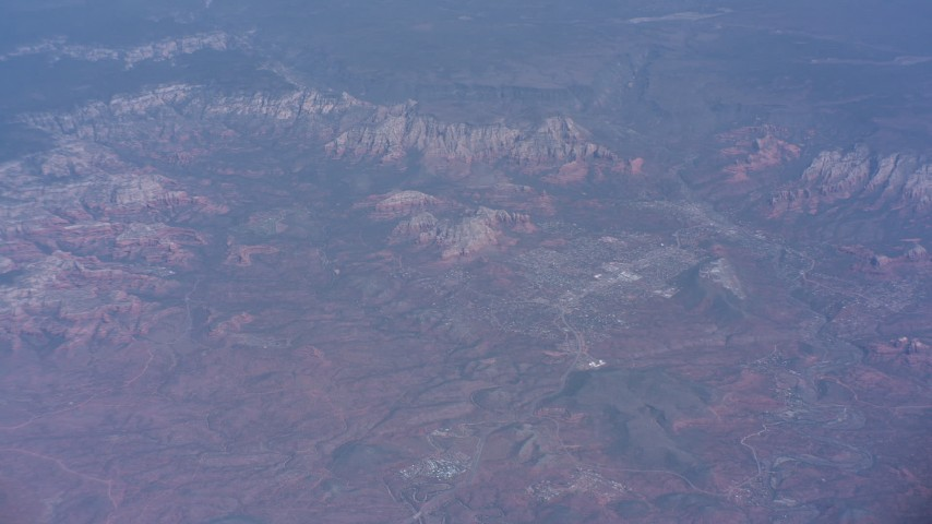 Tilt from a distant peak to mesas and canyons around Phoenix, Arizona Aerial Stock Footage | WA007_023