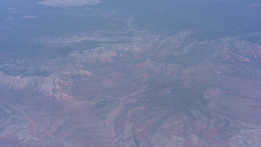 Tilt from a river in the desert to reveal mesas in Arizona Aerial Stock Footage | WA007_025