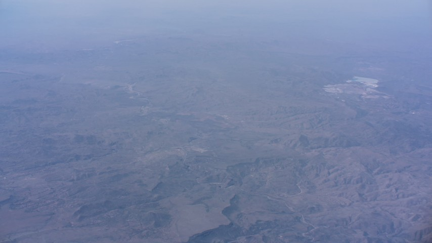 Approach and tilt to the Southern California desert mountains below Aerial Stock Footage | WA007_028