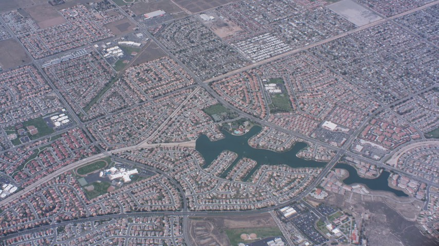 4K stock footage aerial video of a bird's eye view of suburban neighborhoods and lake in Moreno Valley, California Aerial Stock Footage | WA007_036