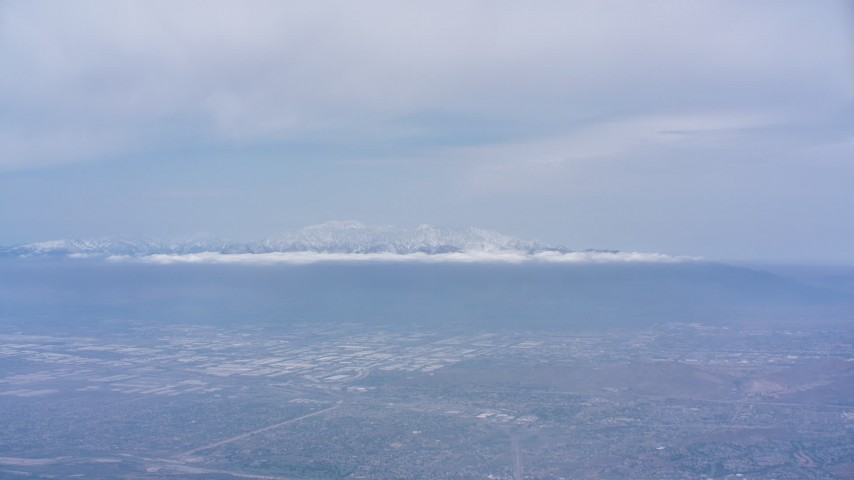 4K stock footage aerial video of the San Gabriel Mountains with snow seen from Riverside, California Aerial Stock Footage | WA007_040