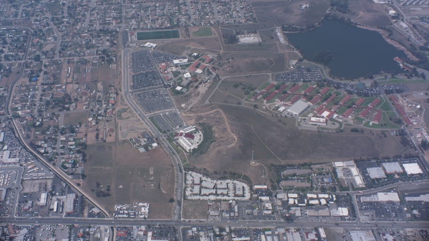 4K stock footage aerial video of a bird's eye view of suburban homes, I-15 and a lake in Norco, California Aerial Stock Footage | WA007_042