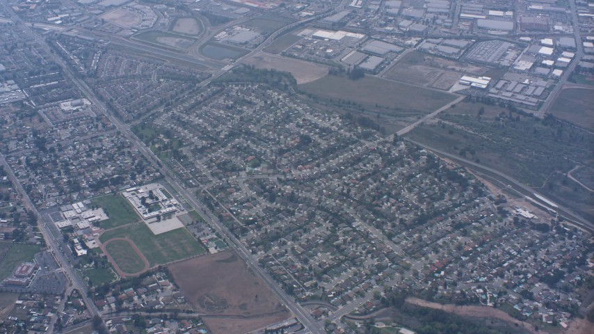 Residential neighborhoods and schools in Norco, California Aerial Stock Footage WA007_043 | Axiom Images