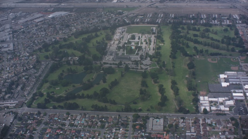 Fly over golf course to approach juvenile hall in Downey, California Aerial Stock Footage | WA007_050