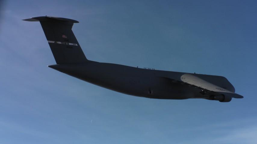 4K stock footage aerial video of a Lockheed C-5 and blue skies, Northern California Aerial Stock Footage | WAAF01_C005_0117RV