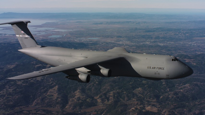 4K aerial video of tracking a Lockheed C-5 flying over hills in Northern California Aerial Stock Footage | WAAF01_C007_01172T
