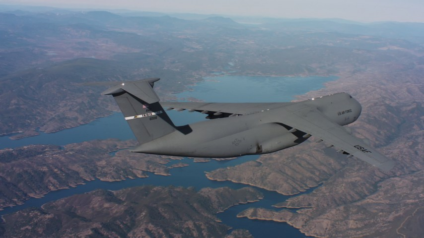 4K stock footage aerial video of a Lockheed C-5 in flight near a lake in Northern California Aerial Stock Footage | WAAF01_C008_0117M6