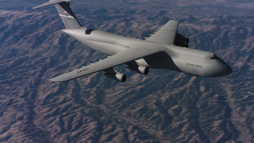 4K stock footage aerial video of flying by the front end of a Lockheed C-5 flying over hills, Northern California Aerial Stock Footage | WAAF01_C015_0117VN