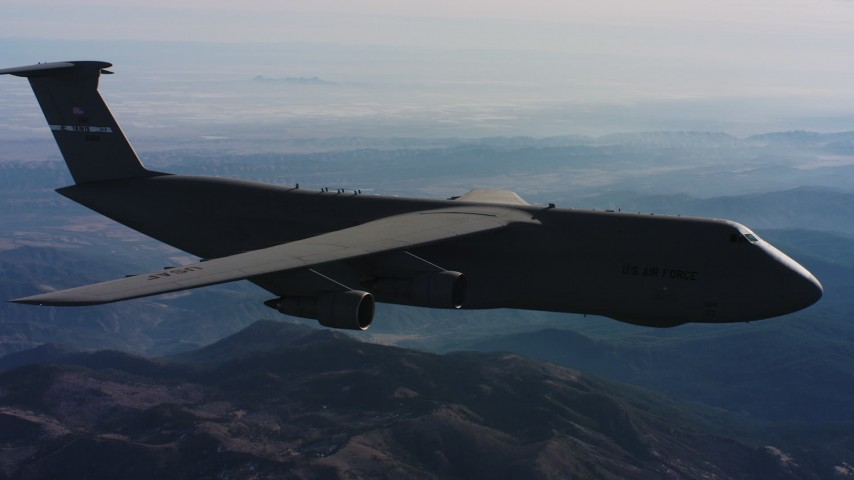 4K stock footage aerial video of a Lockheed C-5 in flight over mountains, Northern California Aerial Stock Footage | WAAF01_C030_0117Q9