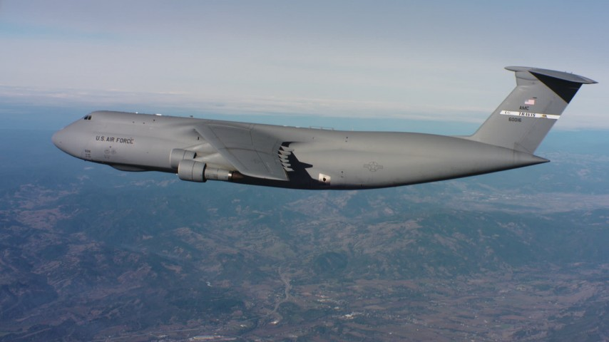 4K stock footage aerial video of a Lockheed C-5 in flight near mountains in Northern California Aerial Stock Footage | WAAF01_C035_0117ES