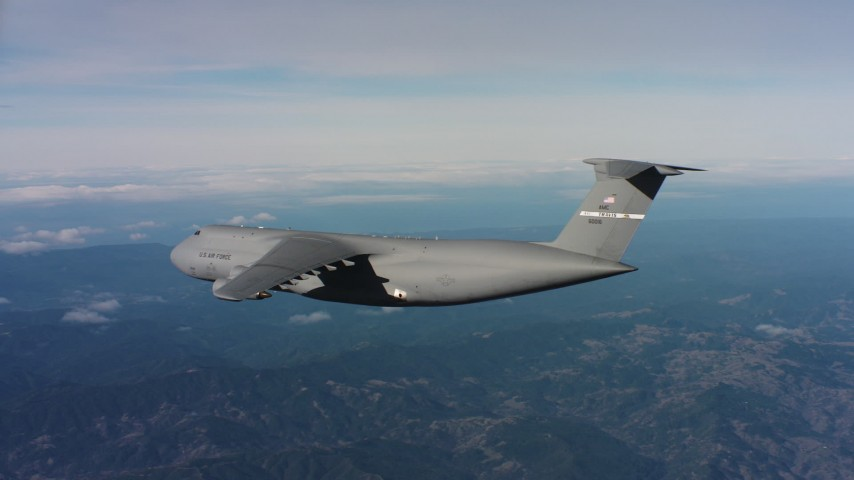 4K aerial video of revealing a Lockheed C-5 flying near mountains in Northern California Aerial Stock Footage | WAAF01_C036_0117T7