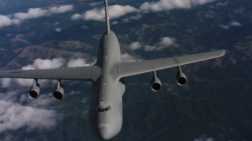 4K stock footage aerial video flyby front of a Lockheed C-5 jet in Northern California Aerial Stock Footage | WAAF01_C040_0117SL