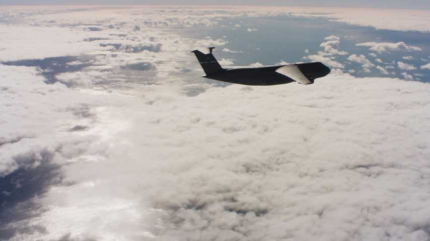 4K stock footage aerial video of a Lockheed C-5 firing flares over cloud cover in Northern California Aerial Stock Footage   WAAF01_C046_011778