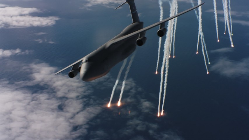 4K stock footage aerial video of passing a Lockheed C-5 dropping flares over the ocean in Northern California Aerial Stock Footage | WAAF01_C050_0117XT