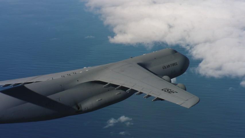 4K stock footage aerial video of flying beside a Lockheed C-5 as it leaves frame in Northern California Aerial Stock Footage | WAAF01_C058_01171J_S000