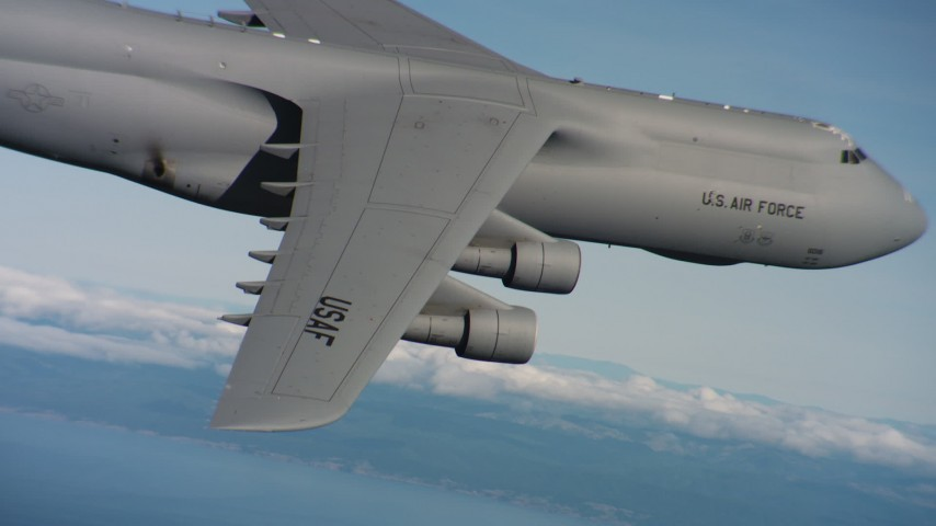 4K stock footage aerial video of a Lockheed C-5 flying near the coast in Northern California Aerial Stock Footage | WAAF01_C063_0117RC