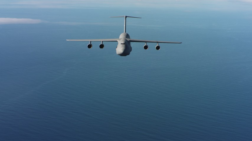 4K aerial video of a reverse view of a Lockheed C-5 flying over the ocean in Northern California Aerial Stock Footage | WAAF01_C066_01178K