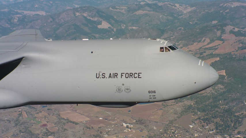 4K stock footage aerial video of the front end and cockpit of a Lockheed C-5 over Northern California Aerial Stock Footage | WAAF01_C071_0117GR
