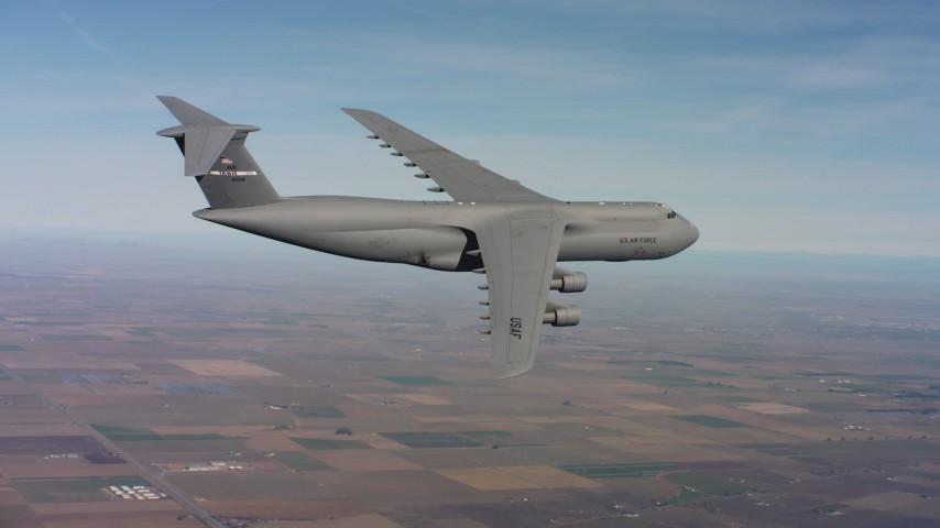 4K aerial video of a Lockheed C-5 in flight over farmland in Northern California Aerial Stock Footage | WAAF01_C078_0117MA