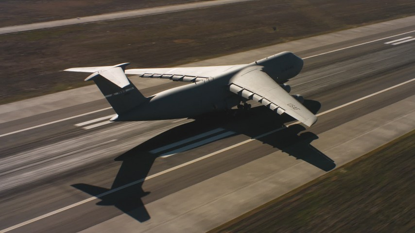 4K stock footage aerial video of a Lockheed C-5 landing at Travis Air Force Base, Northern California Aerial Stock Footage | WAAF01_C085_01177E