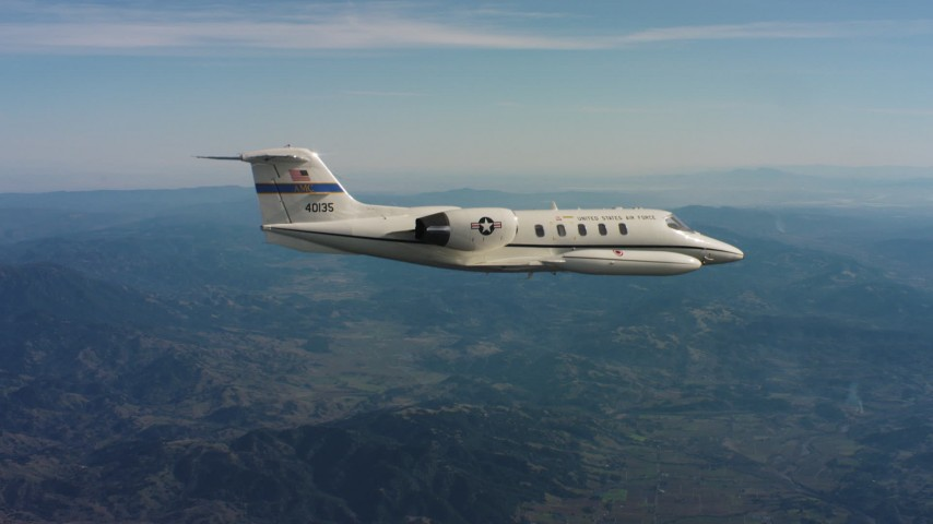 4K stock footage aerial video of a Learjet C-21 plane flying over mountains in Northern California Aerial Stock Footage   WAAF02_C028_0117BJ