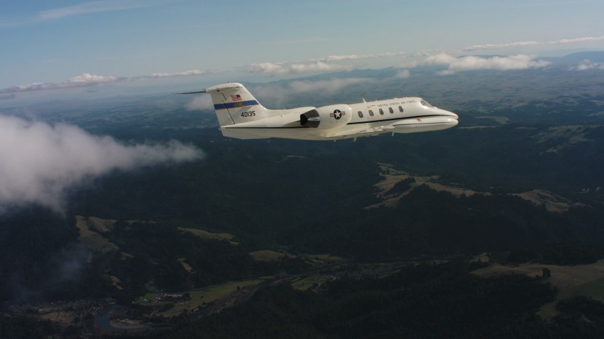 4K stock footage aerial video of a Learjet C-21 in the air over mountains in Northern California Aerial Stock Footage   WAAF02_C031_01177D