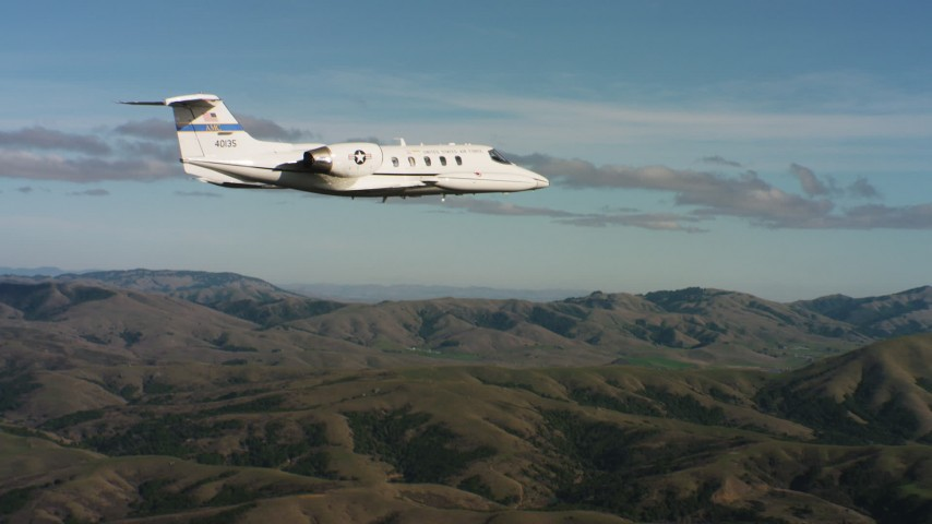 4K stock footage aerial video of a Learjet C-21 flying near hills in Northern California Aerial Stock Footage | WAAF02_C042_0117T2
