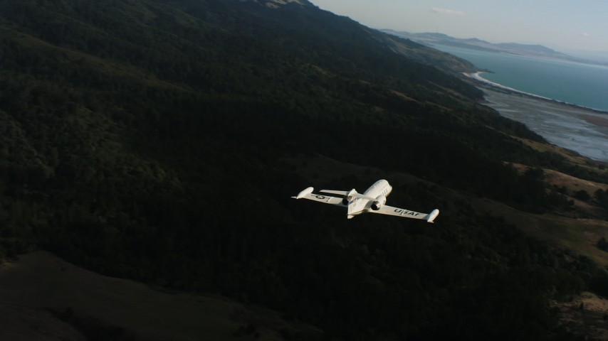 4K stock footage aerial video of a Learjet C-21 flying over coastal hills in Northern California Aerial Stock Footage | WAAF02_C047_0117D7