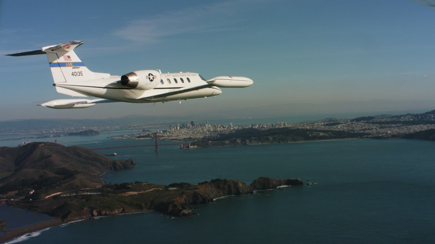 4K stock footage aerial video of a Learjet C-21 near Marin Hills, Golden Gate Bridge and San Francisco, California Aerial Stock Footage | WAAF02_C051_01170K_S000