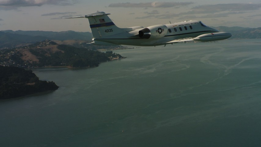 4K stock footage aerial video of a Learjet C-21 flying over the bay, Northern California Aerial Stock Footage | WAAF02_C054_0117PF